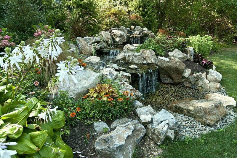 For backyard water features some like it pondless for Pond water features waterfalls