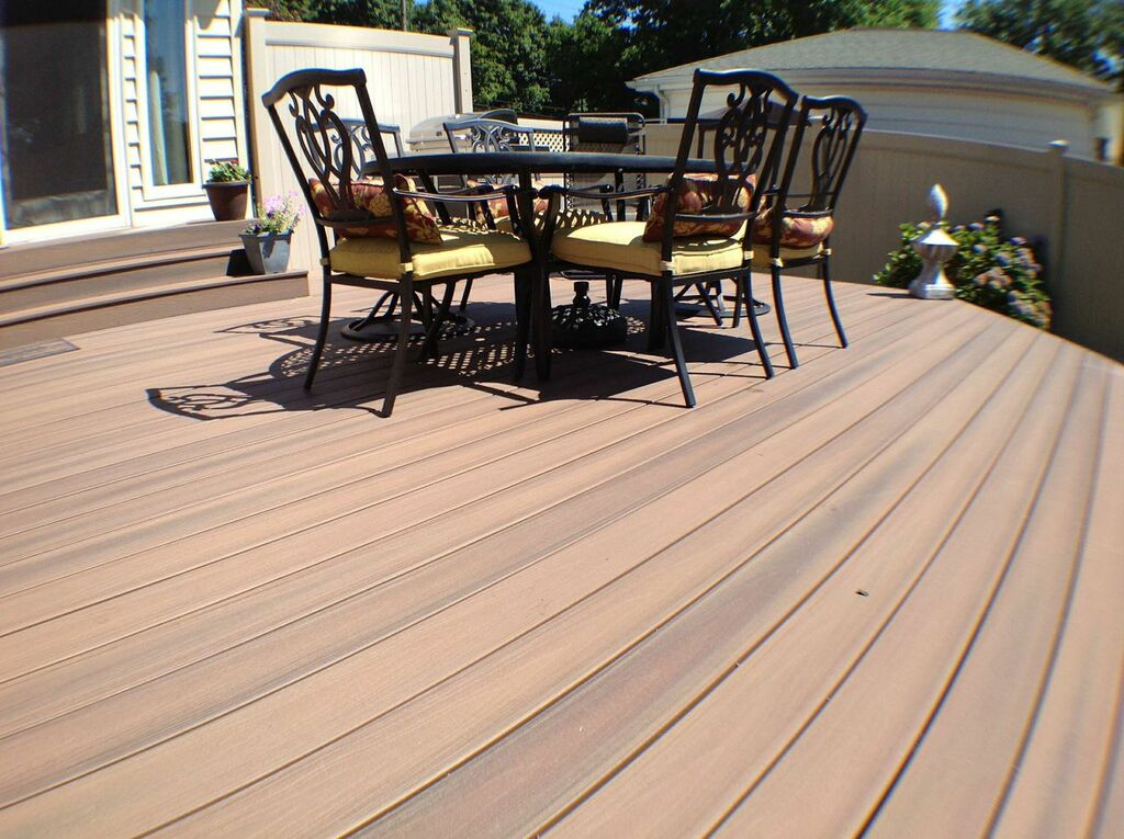 Fiberon Protect Advantage Composite Decking:Cost-friendly, modestly-sized, deck can be beautiful and functional. There is room enough to barbecue, dine, and sun bathe and is conveniently located to kitchen and back door.