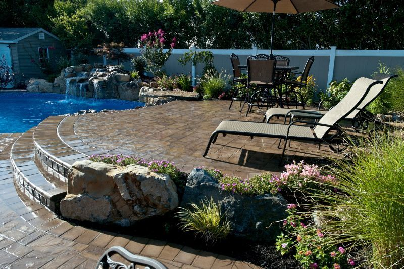 Different Level Patios Flower Beds And Raised Waterfall
