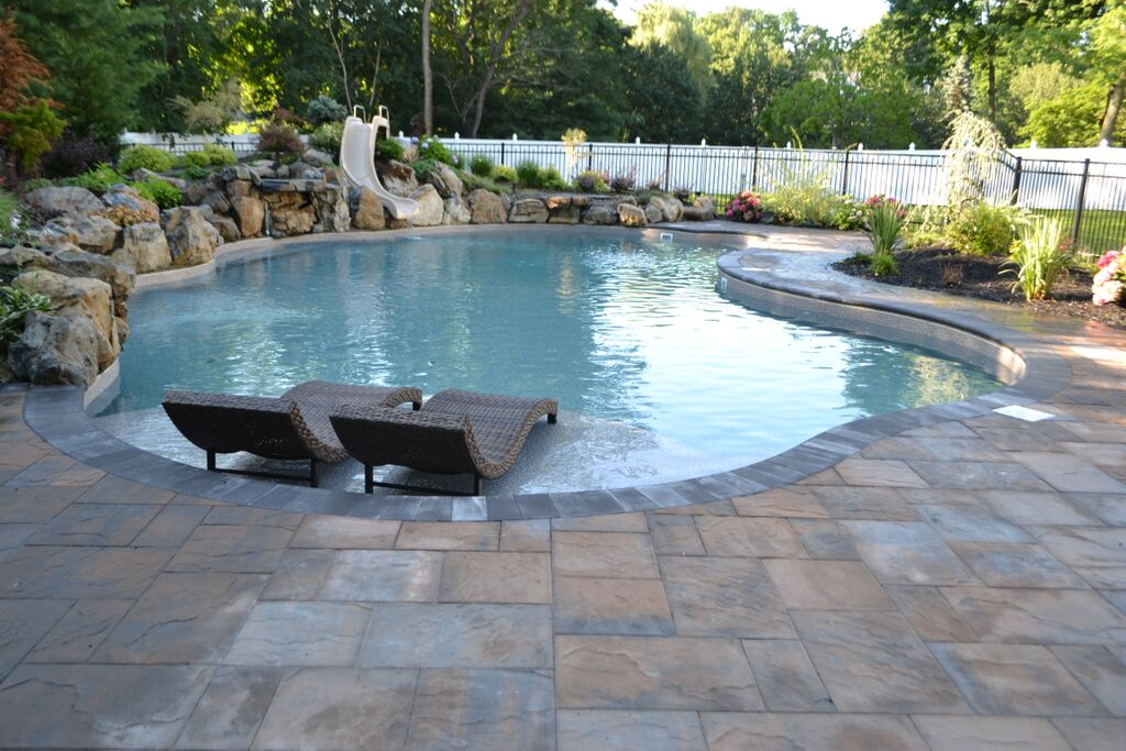 In ground pool with spillover spa there s more than one for Swimming pool surrounds design