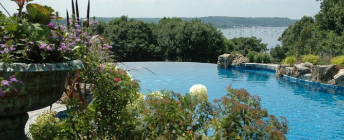 Pool Landscaping (Cove Bay/NY): Landscaping can play a key role in enhancing the experience of an infinity pool.