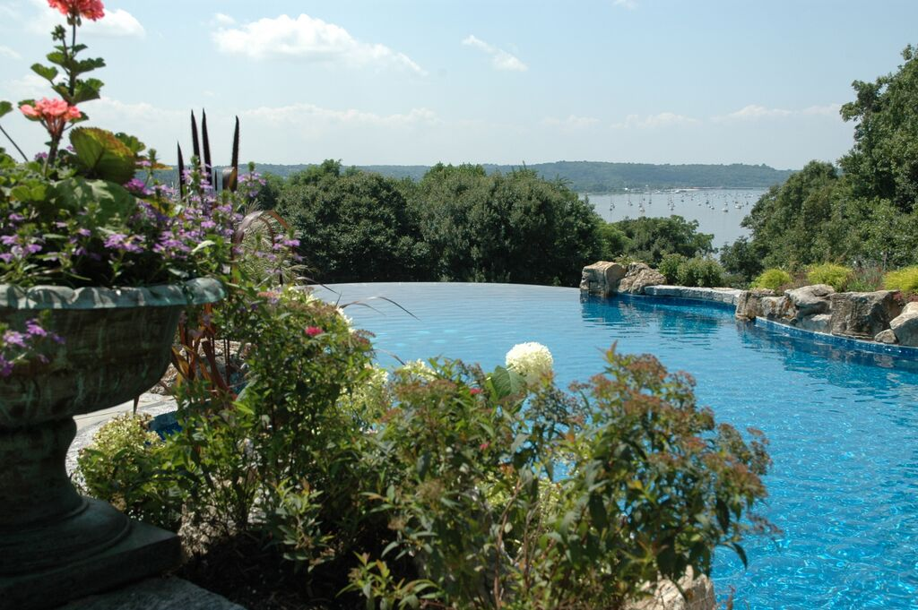 Pool Landscaping (Cove Neck/NY): Landscaping can play a key role in enhancing the experience of an infinity pool.