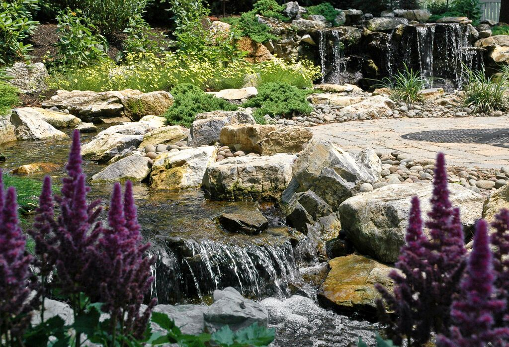 Rainwater Harvesting (Long Island/NY): The Aquascape 'green' RainExchange process combines a decorative water feature with a completely sub-surface collection system -- thereby creating a beautiful backyard oasis that is very eco-friendly.