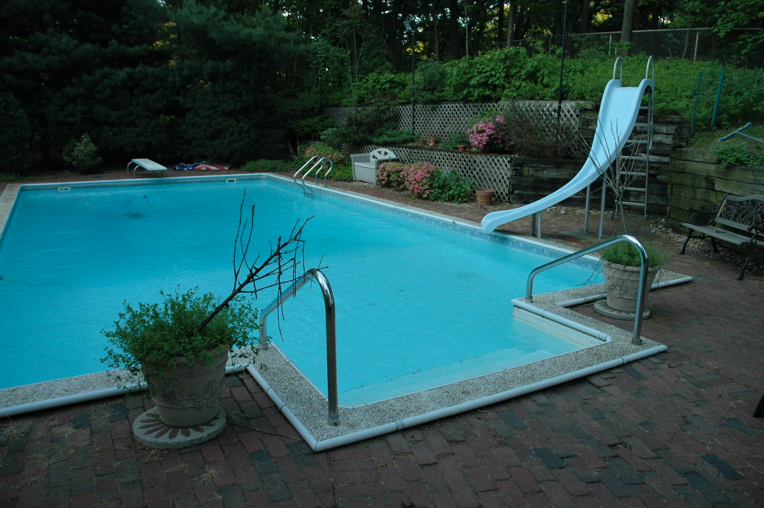 Upgrading pool and backyard new landscaped slope replaces for Pool design retaining wall