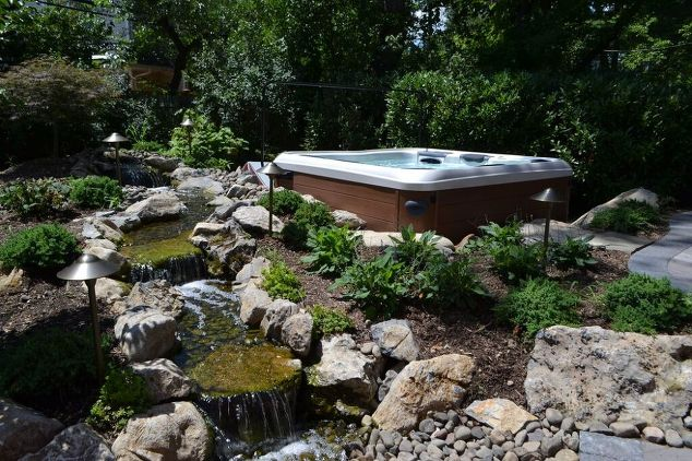 This pondless waterfall/stream was installed beside a portable Bullfrog Spas. The stream is a lovely, tranquil sight from the patio as well as the hot tub itself.