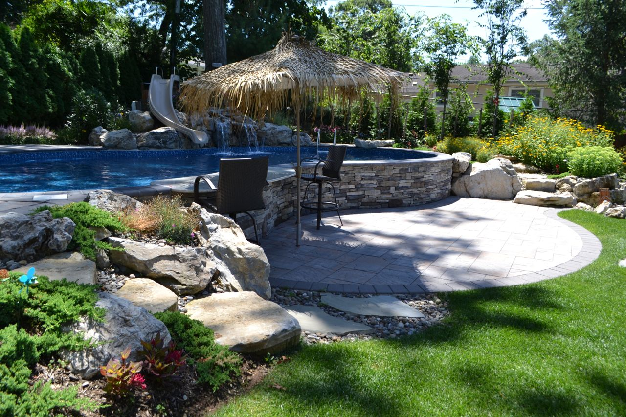 Pool surrounds for Pool design for sloped yard