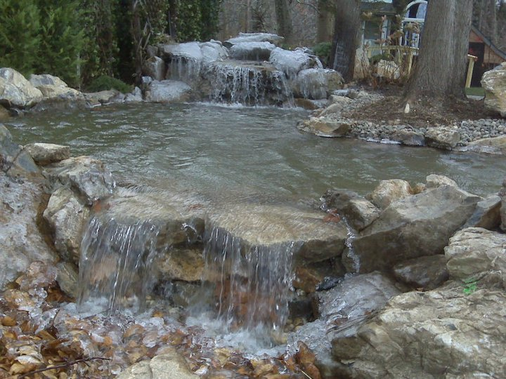 Water Features in Winter: (Long Island/NY) - During a prolonged cold snap, ice forms on the natural stone boulders of this water feature; the water falling over the stones crystalizes into glistening flowing threads — an exquisite sight!