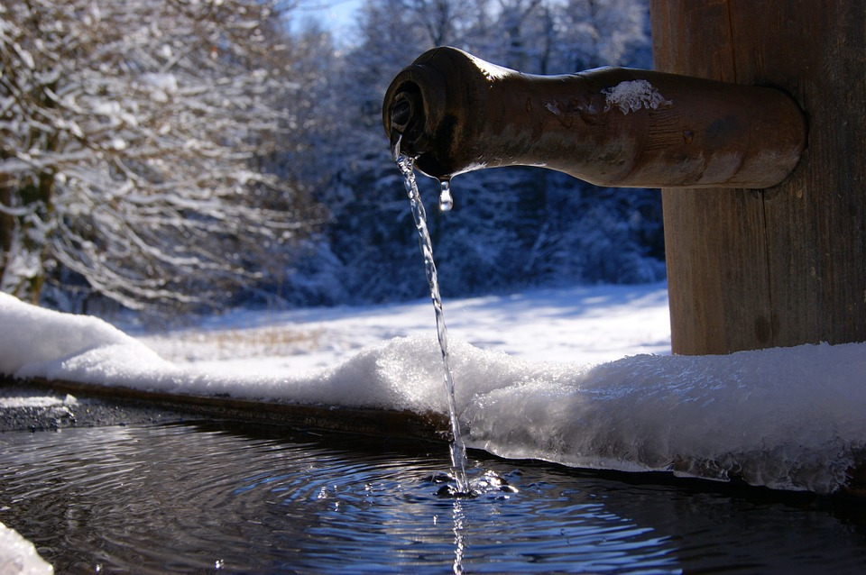 Fountainscapes in Winter: This fountainscape is part of a fountain/miniature pond feature that is arguably even more delightful in winter months than in summer. Note how the small stream of water has become a jeweled thread of ice.