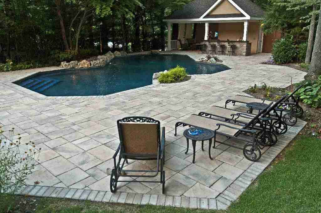 To stay within budget, we kept the existing pool but upgraded it with all new plumbing, main drain, returns and skimmers, new pool equipment, and a new finish on the pool interior.