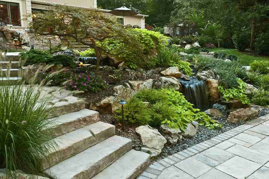 We have a terrific way of cutting costs and increasing the aesthetic value of graded property by using large moss rock boulders instead of expensive and unattractive retaining walls.