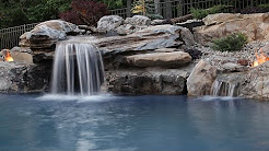 Close Up of Pool Waterfalls: This is a close up of a part of the water feature we built for Pool Kings. At center, you see the main waterfall that runs over the front of the grotto.