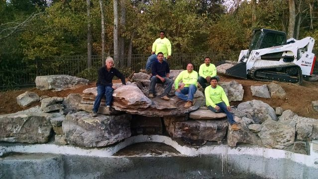 Positioning Swimming Pool Grotto Rock: This is a photo of our team after we finally got the two-ton top grotto rock in place.