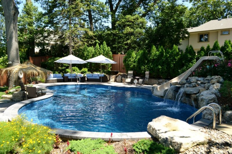 Small sloped yard fitting a pool and other outdoor living for Pool design for sloped yard