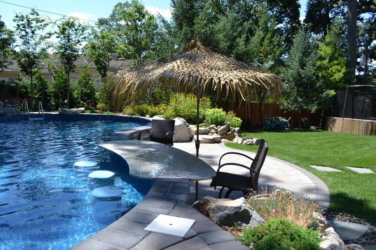 Small Yard Goes Big With Amenities An Impressive Granite Swim Up Bar