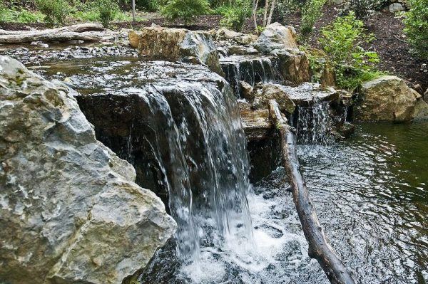 Pond Waterfall (Long island/NY): Our designers incorporated a 12' waterfall with a 20,000 gallon-per-hour water flow. This helps keep the pond fresh and aerated with oxygen.