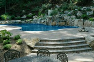 Pool Landscaping by Deck and Patio