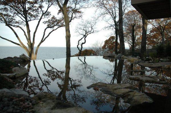 The vanishing edge pond in fall