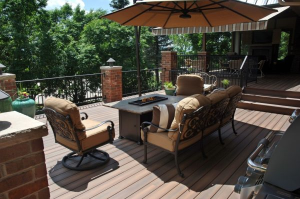 A fire pit adds warmth and is the perfect place to roast a marshmallow for s'mores. Photo: Fiberon Decking and Railing