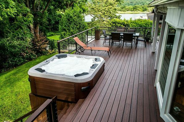 "Decks and Hot Tub (Centerport/NY): We matched the hot tub platform boards to the Trex ""Lava Rock"" Transend decking for a harmonious look to it all."