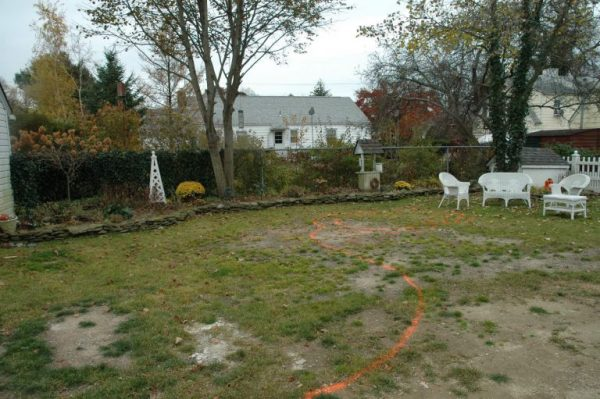 'Before:' Deck and Patio used orange paint to mark the areas for the new spool, waterfall, patio and landscaping.