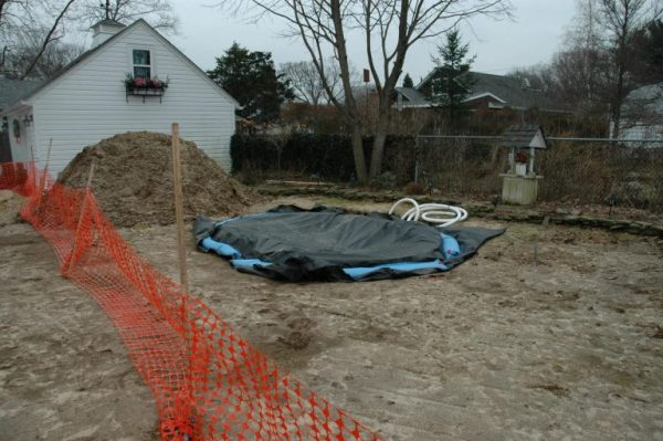 """""""During"""" Spring As soon as spring came, we began building the concrete shell. As you can see the ground was still hard but the hole was already dug allowing us to proceed early."""