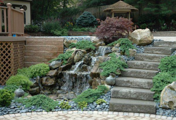 Waterfall Softens Retaining Wall