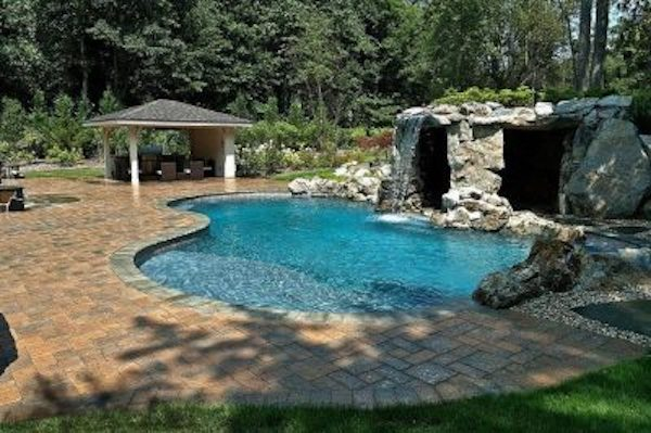 The high waterfall spills into the pool — just outside from a grotto-spa where you can escape from the heat of the sun.