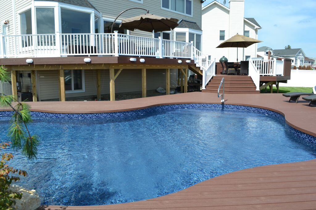 Elegant Multi Level Deck And Freeform Pool