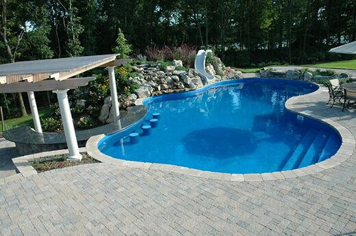 In This Design And Build Project We Added A Swim Up Bar The Main Pool That Features Granite Countertops As Well Stools Out Steps