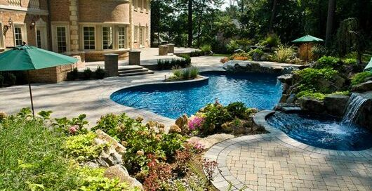 Free-Form Pool with Raised Spa and Waterfalls