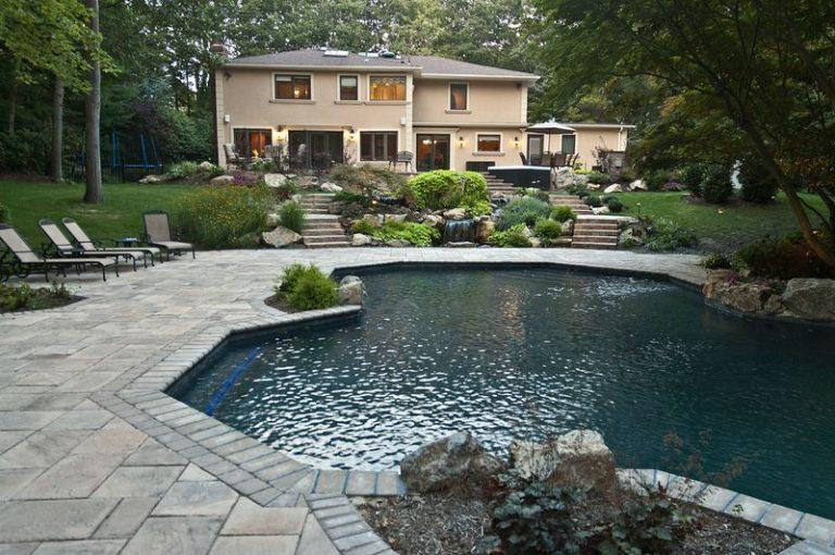 Total Backyard Upgrade Along Sloping Property Setting